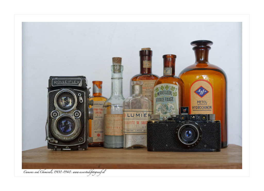 still life of vintage cameras and chemicals